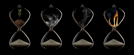 Four elements of fire, plant, water and air in a hourglasses Stock Photo