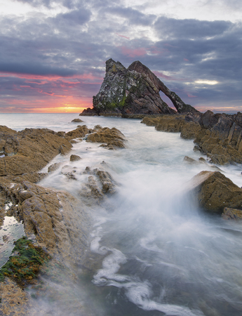 Bow-fidle Rock sunrise landscape on the coast of Scotland on a cloudy morning
