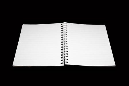 isolated notebook on black background photo