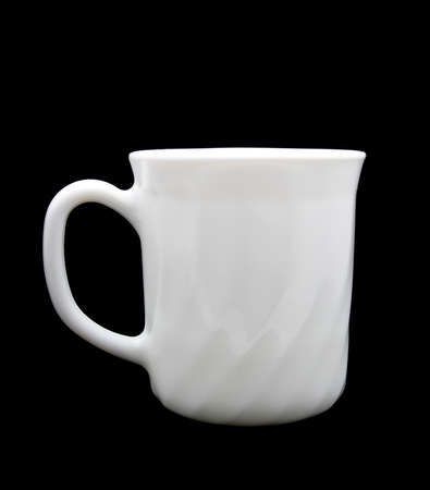 white cup isolated on a black background  photo