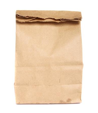Bruine papieren zak geïsoleerd op wit   Stockfoto