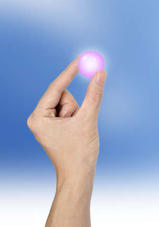 potential: Hand holding a blue crystal ball shine isolated on sky background