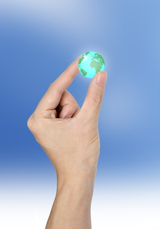 Hand holding the Earth isolated on sky  background photo