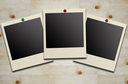blank photos on a wood background Stock Photo - 9894134