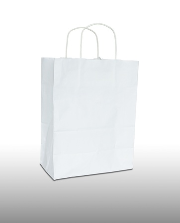 gift bag: white paper bag isolated on white background Stock Photo