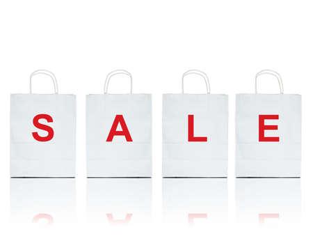shopper in bianco con la vendita di parola su bianco