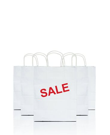 white shopping bags with the word sale on white Stock Photo - 9894050