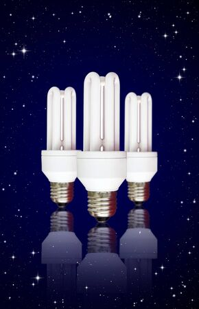 florescent light: isolated compact florescent light bulb on night sky background  Stock Photo