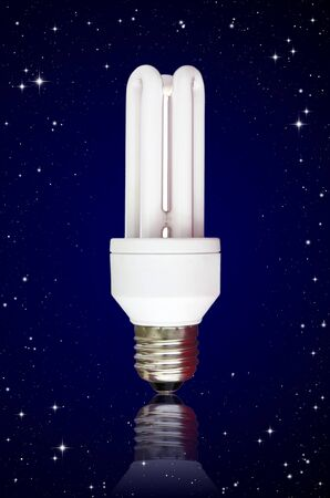 starlit: isolated compact florescent light bulb on night sky background Stock Photo
