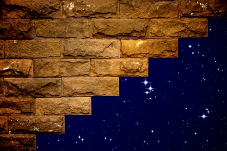 night sky with light through the hole in the brick wall Stock Photo - 10020068