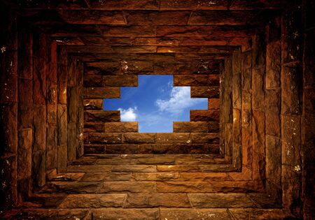 Blue sky with sunlight through the hole in the brick wall room photo