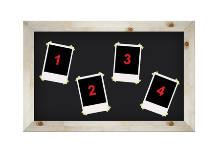 blank photo frames on blackboard isolated on white photo