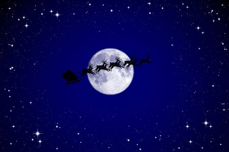 sprightly: Santa Claus On Sledge With Deer And white Moon Stock Photo