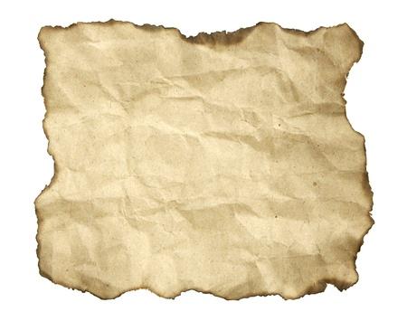 quemadura: Papel viejo con bordes quemados en blanco Foto de archivo