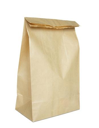 school bag: Bolsa de papel marr�n aislada en blanco Foto de archivo
