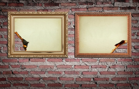 antique gold picture frames: vintage gold frame with burned on wall  background Stock Photo