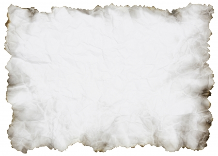 crumpled paper with burnt edges over white photo