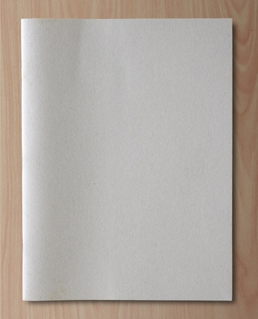 gray recycled notebook on wood background photo