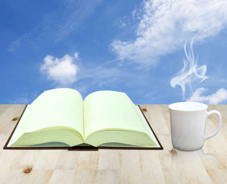 open book and cup of coffee photo