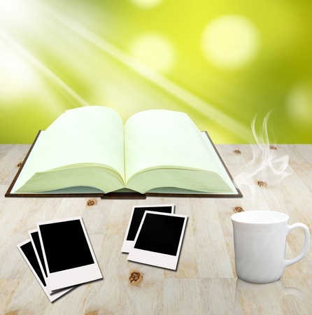 instant coffee: open book and instant photo with cup of coffee Stock Photo
