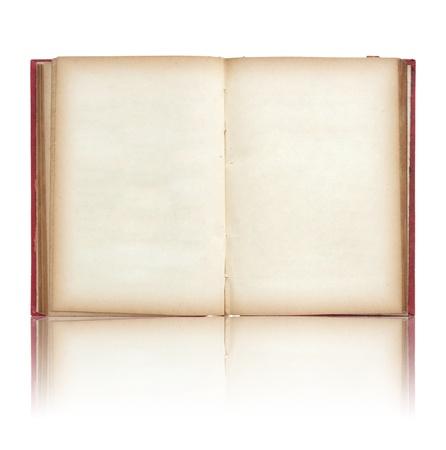 Oud boek open op reflecteren vloer en witte achtergrond Stockfoto