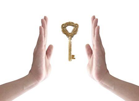 thumb keys: the key to success (hand holding key isolated on white) Stock Photo