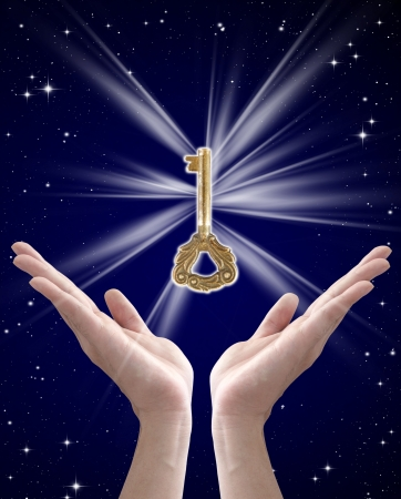 golden key: the key to success (hand holding key against night sky)