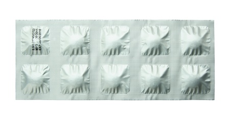 Pack of pills isolated on white background photo