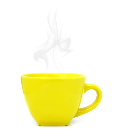Yellow cup with hot drink on white background photo