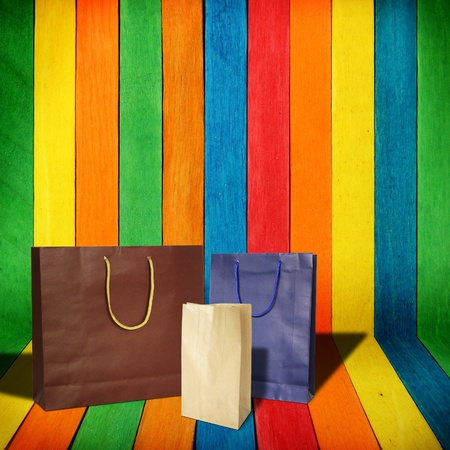 shopping bags on colorful wood Background photo