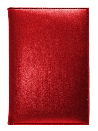 Red leather note book isolated on white background photo