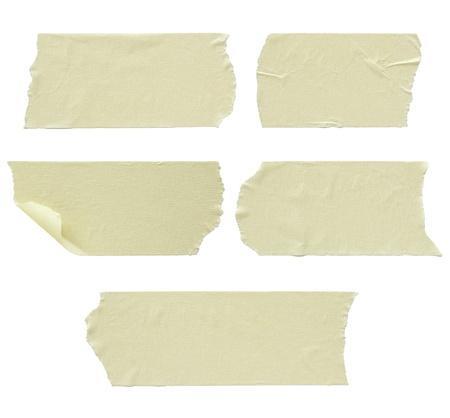 masking: Set of torn masking tape isolated on white
