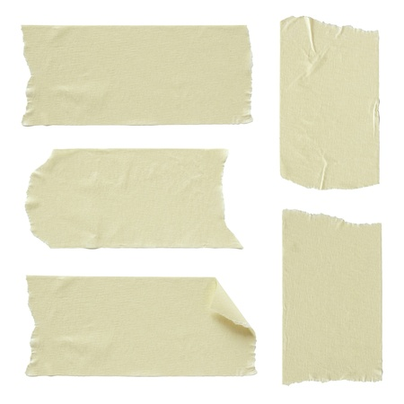 torned: Set of torn masking tape isolated on white