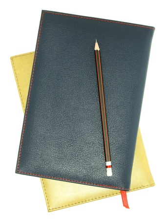 stack of leather notebook and pencil isolated on white Stock Photo - 14481139