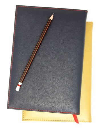 stack of leather notebook and pencil isolated on white  photo