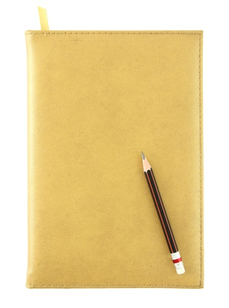 yellow leather notebook and pencil isolated on white photo