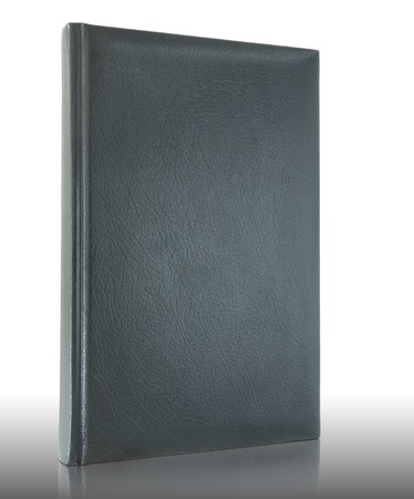 Black empty leather book on reflect floor and white background photo