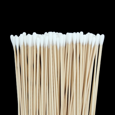 Cotton swabs isolated on black background photo