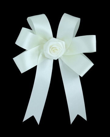 White satin gift bow  Ribbon  Isolated on black with clipping path photo
