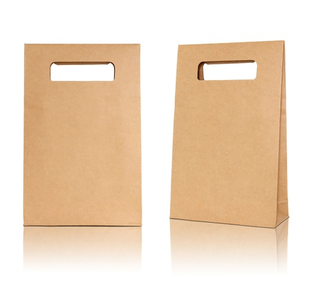 Brown paper bag on reflect floor and white background photo