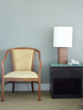 chair and table lamp in bedroom photo