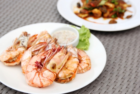 grilled shrimps with seafood sauce on white plate photo