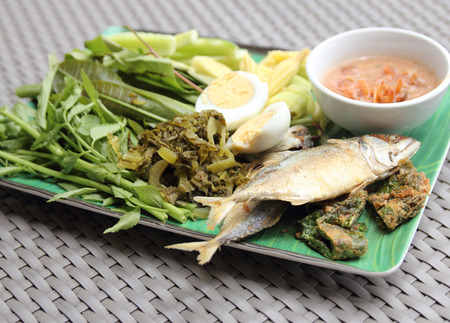 Fried Mackerel fish,chili sauce and fried vegetable photo