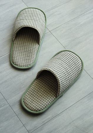 Slippers on the floor tile photo