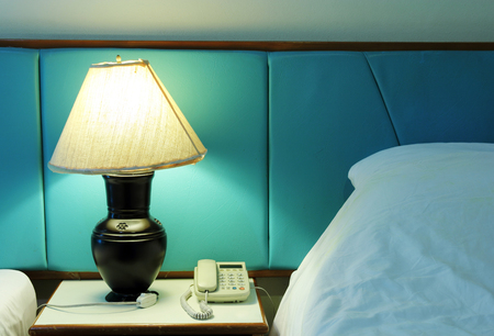 table lamp and phone on bedroom photo