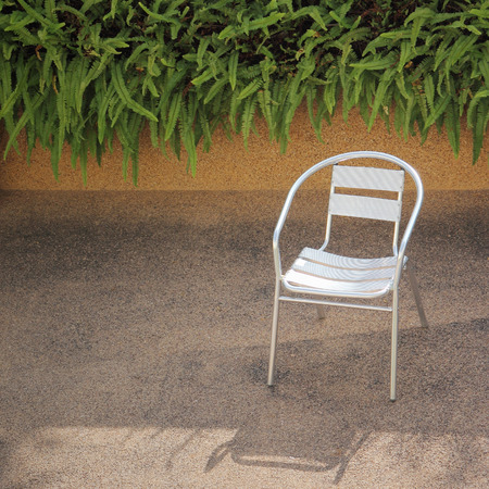 Stainless steel chair in a garden photo