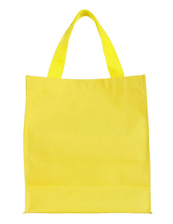 yellow canvas shopping bag isolated on white background with clipping path photo