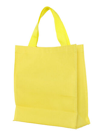 fabric bag: yellow canvas shopping bag isolated on white background with clipping path