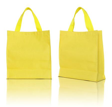 yellow shopping bag on white background  스톡 콘텐츠