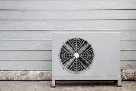 heat home: air compressor is outside the office building Stock Photo
